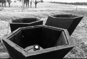 MiniSODAR, showing transducer. Note the proximity of trees, away from the beam, which do not create reflections or background noise.